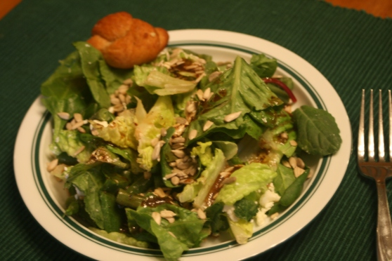 Leftover green salad with romaine, spinach, kale, chard, sunflower seeds, feta, green beans, balsamic vinaigrette and a homemade garlic knot!  Complicated salads make me happy!